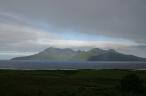 Fig. H9.3. View of south-east side of Rùm, from Laig, Eigg (J Hooper) - click for a larger image