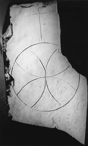O2.4 An incised compass-drawn cross from St. Boniface's, dating to the late seventh or early eighth century (NMS) - click for a larger image
